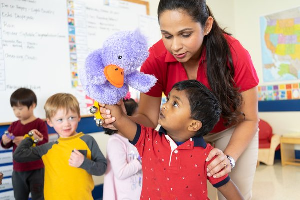 Teacher with child and puppet