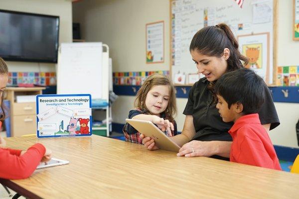 Teacher sitting with children